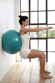 Squat with swiss ball against the wall